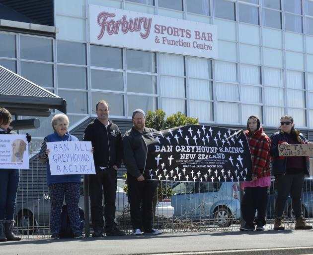A small group of protesters stand outside Forbury Park raceway yesterday. Photos by Gerard O'Brien.