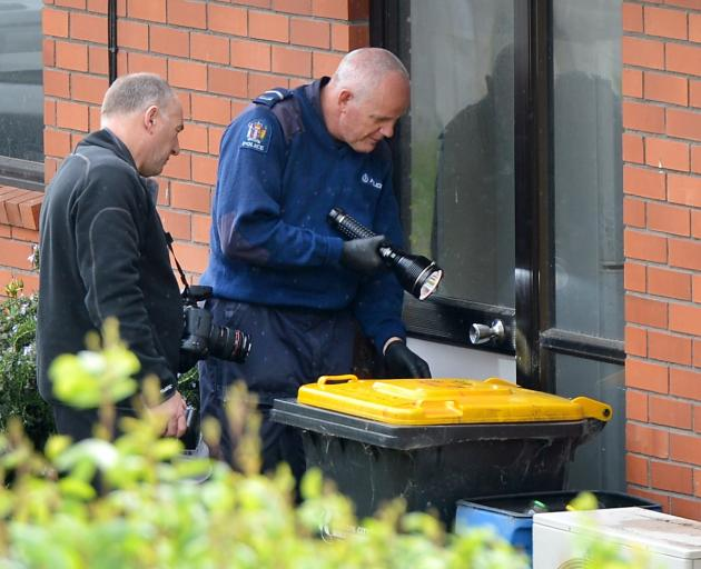Police at the scene of the weapons theft. Photo ODT files