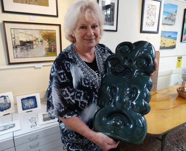 Oamaru artist Jill McIntyre is happy to be reunited with the tiki she created. The item was...