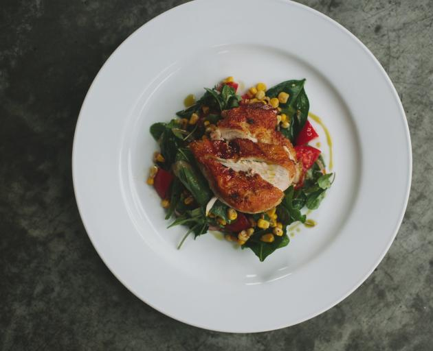 Roast free-range chicken with sweet corn, tomato, basil and lime. Photo from ODT files.