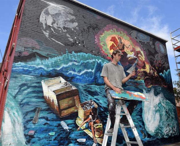 Artist Guy Howard-Smith works on his mural in Castle St yesterday. PHOTO: STEPHEN JAQUIERY