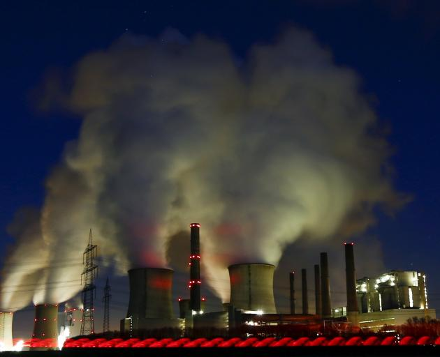 Steam rises from the chimneys of the coal power plant of RWE Power, one of Europe's biggest...