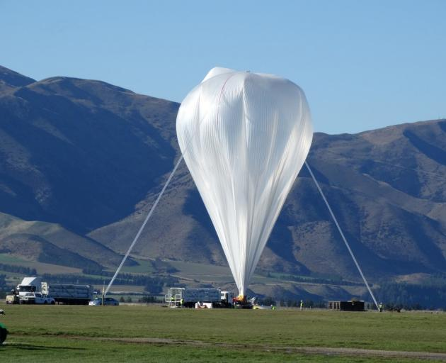 NASA's super pressure balloon nears full inflation before a launch at Wanaka Airport in July last...