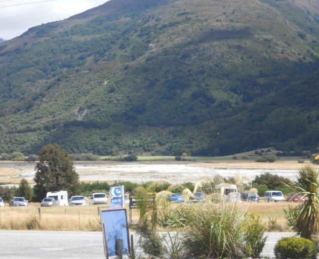 The number of vehicles seen yesterday in a car park used by trampers indicate people may be in Mt Aspiring National Park today as pest control work starts. Photo supplied.