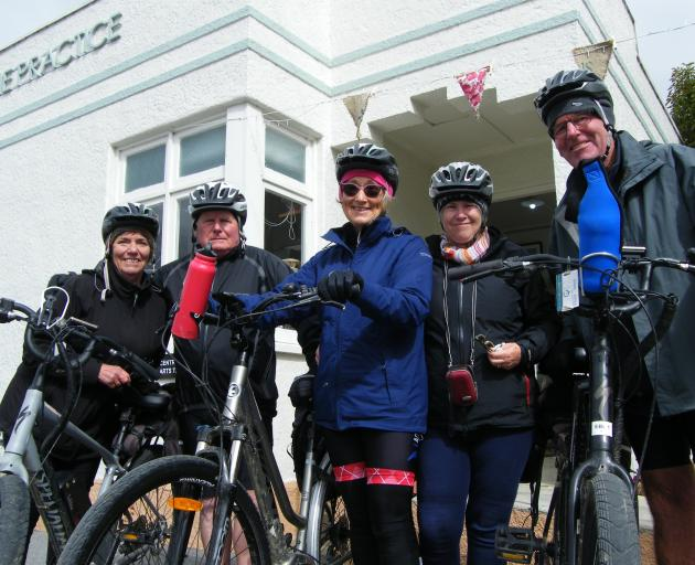 Electric bike riders (from left) Jenny Martin, Herb and Fiona Isherwood, of Auckland, and Dale and Roger Schick, of Dargaville, take a break in Ranfurly from cycling the Otago Central Rail Trail. PHOTO: PAM JONES