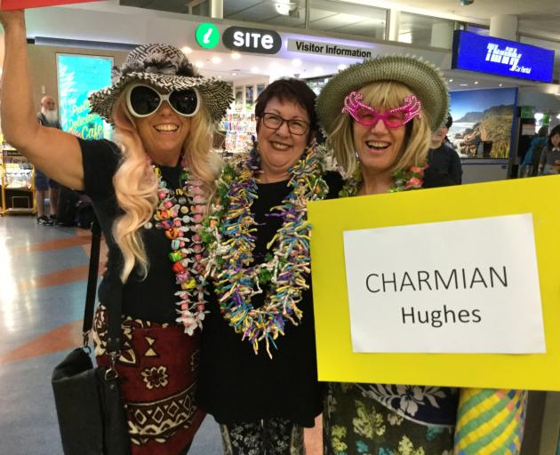 Greeting English comedian Charmian Hughes at Auckland Airport (from left) Shelley Gane, of Auckland, Salina Davies, of Australia, and Patsy Sim, of Auckland. Photo supplied.
