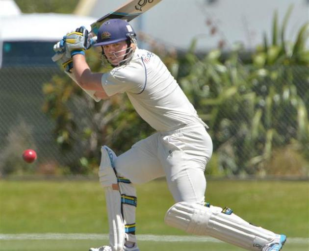 Otago batsman Michael Bracewell blasts a cut shot to the boundary during the fourth day of his...
