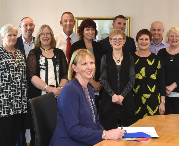 (Front sitting) Otago Community Trust chief executive Barbara Bridger and (from left) donations...