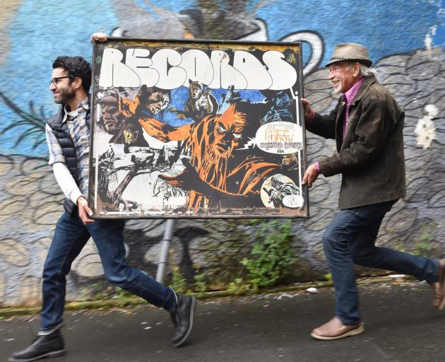 Los Angeles-based music producer Adam Samuel Goldman (left) and former Alley Oop editor Jeff Ruston carry the RECORDS RECORDS sign to Robbie Burns Pub for the Dunedin Fringe Festival show Anything Can Happen: Strange Echoes of the Dunedin Sound. Photo by