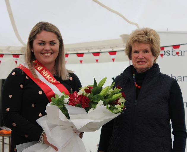 Georgie Bell (left), whose family has been involved with the Southland A&P Show for three generations, is presented with the John Robins Youth Ambassador Award by Mr Robins' wife Joyce at Donovan Park on Friday night. Photo by Nicole Sharp.