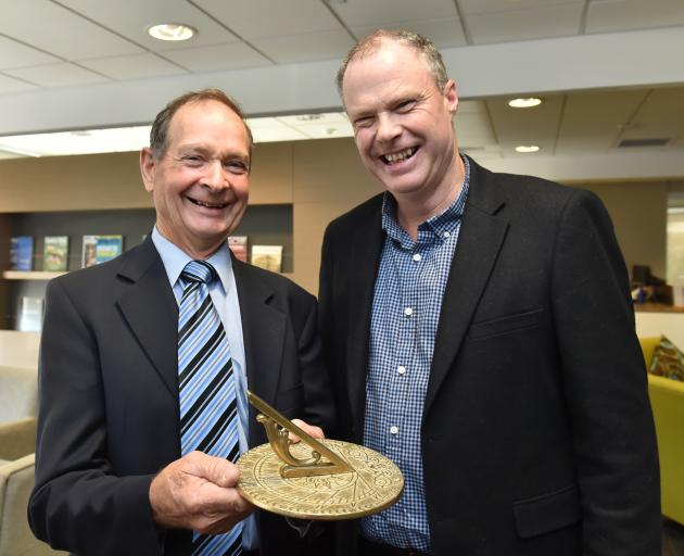 Retiring TracMap chairman Pat Garden (left) with the sundial he received as a retirement gift, and new chairman Chris Dennison. Photo by Gregor Richardson.