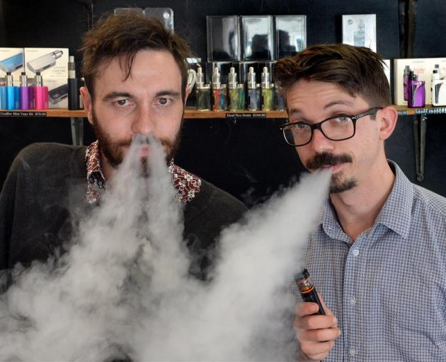 Dunedin e-cigarette store Vapourium account manager Cody Peneamene (left) and operations manager Joseph Rennie exhale vapour from their e-cigarettes. Photo by Linda Robertson.