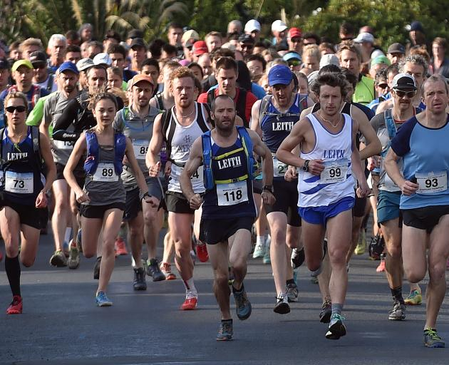 Competitors roar out of the blocks at the start of the Three Peaks mountain race in Dunedin yesterday. In the front are (from left) Sharon Lequeux, Sophie Smith, Jake Jackson-Grammer, Simon Green, Geoff Williams and eventual winner Stafford Thompson. Phot