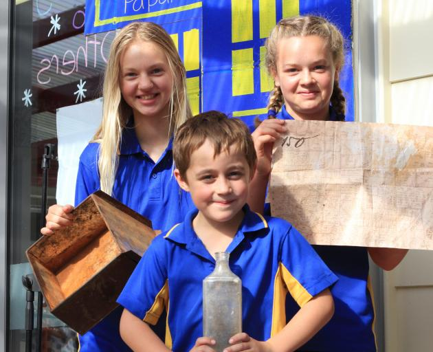 Holding the ``magical'' discovery that inspired a time capsule are Papakaio pupils (from left) Lena Dupu (11), Owen Elliott (8) and Georgie McCarthy (12). Photo by Hamish MacLean.