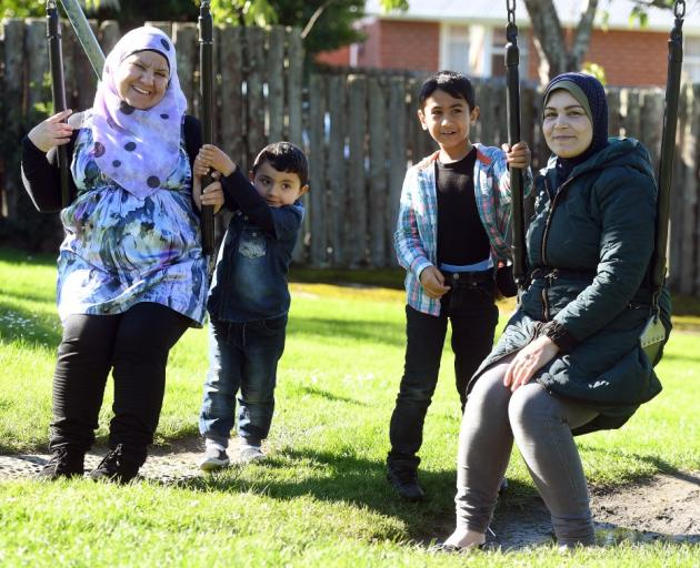 Enjoying themselves in a park in Brockville are (from left) Ahlam Safar, her son Ibrahem Abs (3),...
