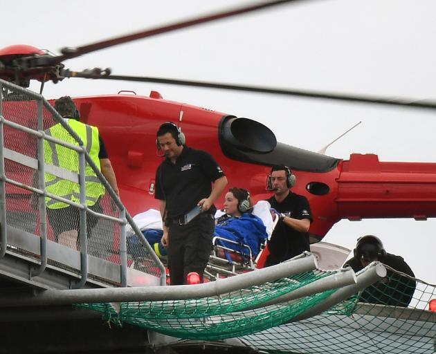 The woman is transferred from the Otago Regional Rescue helicopter to Dunedin Hospital yesterday....
