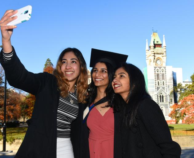 Taking a selfie in front of the University of Otago clocktower are (from left) Lizelle Borges, Vishwa Jani and Namratha Giri, all of Auckland. Photo: Gregor Richardson.