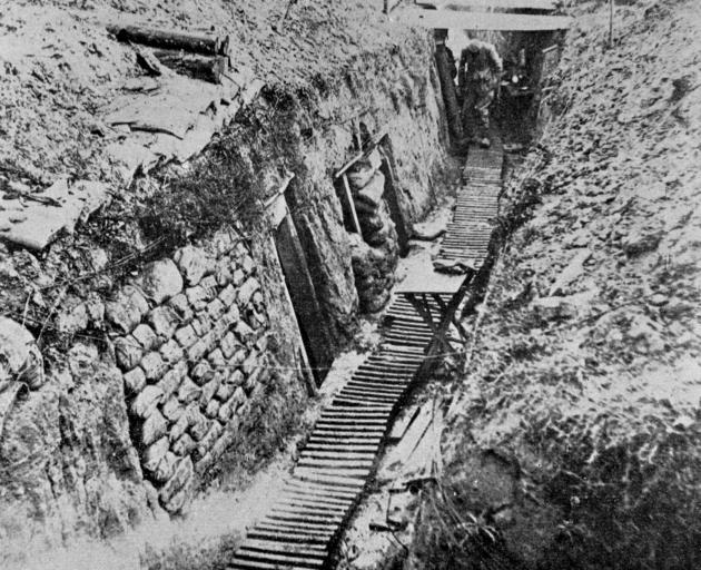 A well-appointed German trench at the Somme, showing its formidable depth and excellent upkeep and appointments. - Otago Witness, 9.5.1917.