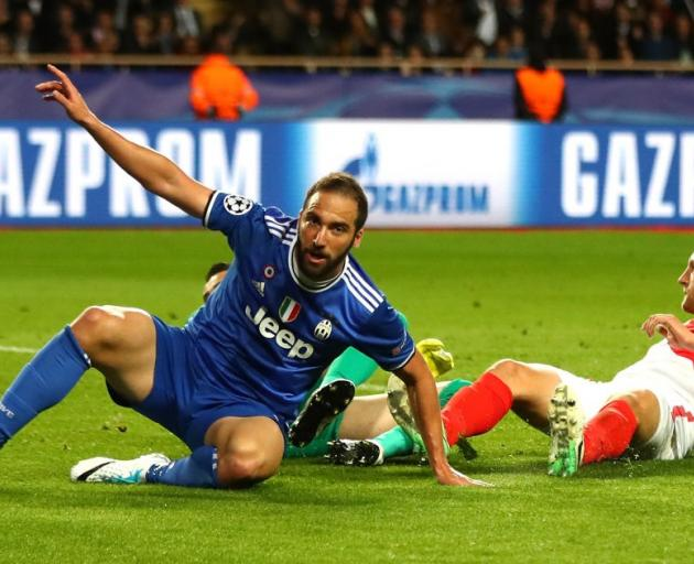 Higuain and Buffon star at each end as Juventus beat Monaco