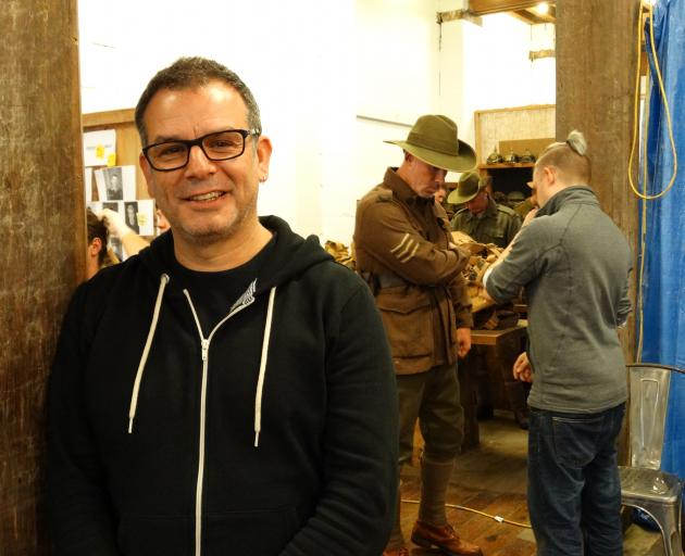 Australian film director Serge Ou is in Oamaru filming scenes for a World War 1 installation to open in France next year. Behind him, Oamaru's Glen Marshall is fitted out for his role as an Australian soldier by costumer Tim Hodgman. Photo: Daniel Birchfi