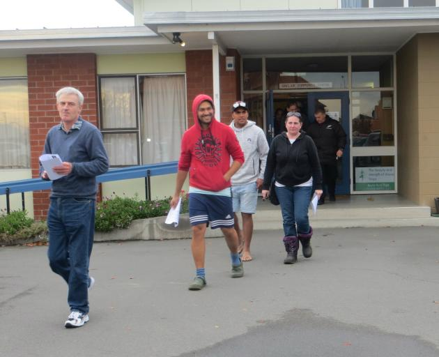 Workers at Silver Fern Farm's Fairton plant leave the meeting where they heard proposals for its closure. Photo: John Keast
