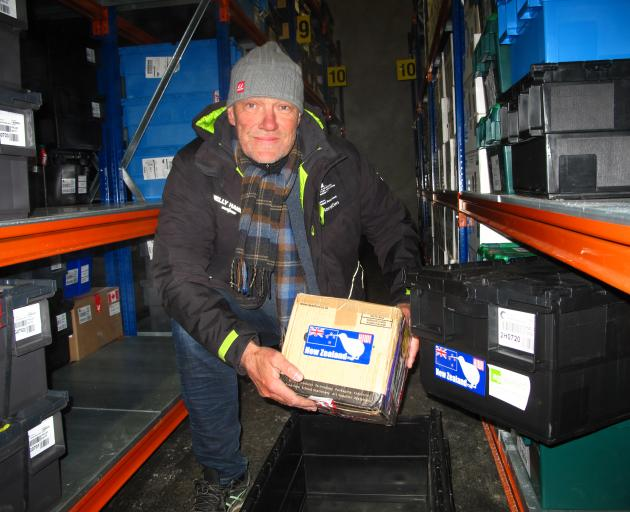 Svalbard Global Seed Vault co-ordinator Asmund Asdal, from the Nordic Genetic Resource Centre, holds the New Zealand seed package. Photo: Nordgen.