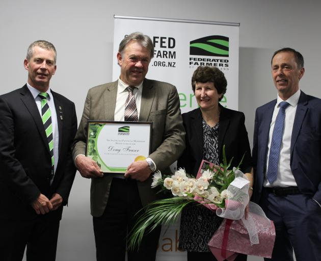 Doug Fraser (second from left) with his wife, Jan, receives his life membership to Federated Farmers from Southland president Allan Baird (left) and Don Nicholson (far right), at the Southland Federated Farmers AGM recently. Photo: Nicole Sharp