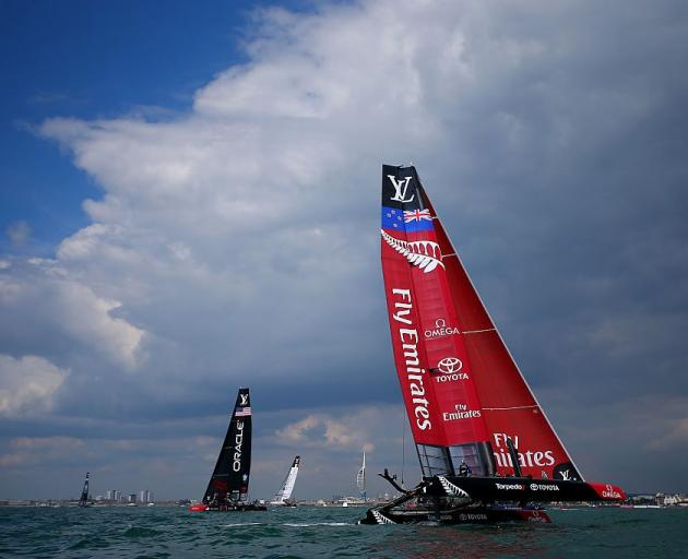 Team New Zealand competes in the America's Cup World Series, with Oracle in the background in...