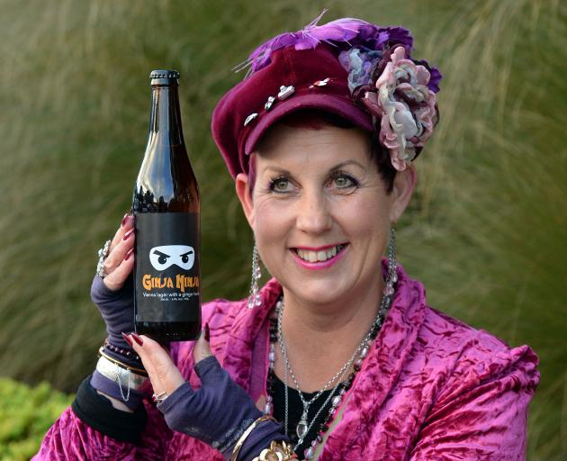 """Gypsy brewer'' and creator of Ginja Ninja Vicki Yarker-Jones with a bottle of her fundraising,..."