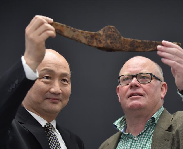 Overseas Chinese History Museum of China director Huang Ji Kai (left) and University of Otago department of anthropology and archaeology head Prof Richard Walter admire a pickaxe head found in a Chinese camp near the Lawrence goldfield. Photo: Peter McInt