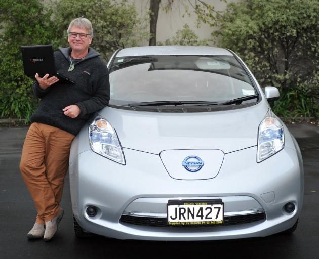 One of the two men behind an electric vehicle data collection system, emeritus Prof Henrik Moller, beside his electric vehicle last week. Photo: Christine O'Conner