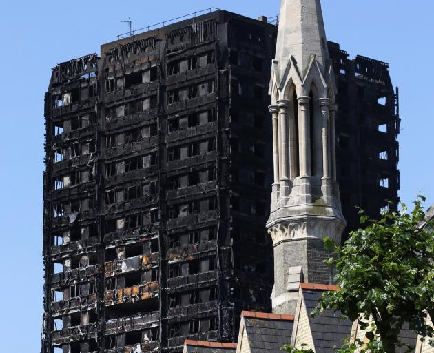 The apartment building was burned out though remains standing. Photo: Reuters