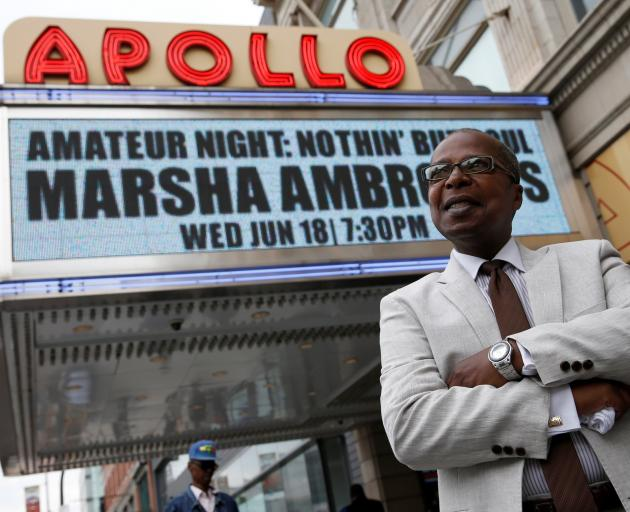 Historian Mitchell poses outside the Apollo Theater in the Harlem, NYC. Photo: Reuters