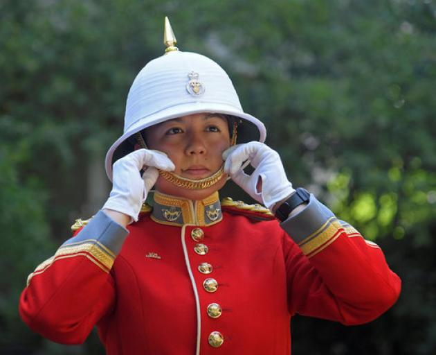 Captain Megan Couto of the 2nd Battalion poses for a photograph as she prepares to command the Queen's Guard. Photo: Reuters