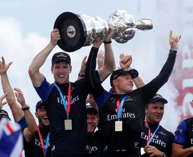 Peter Burling lifts the America's Cup after Team New Zealand's win in Bermuda. Photo: ACEA 2017