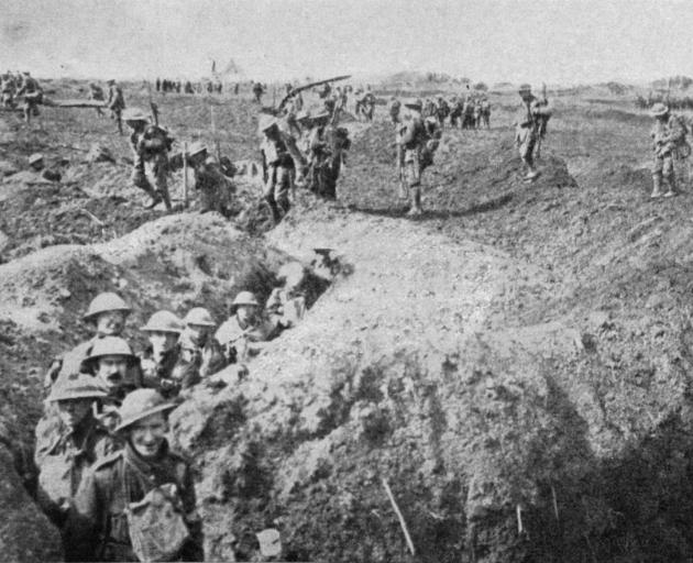British support troops filing through a trench on the way to join an attack on the Western battlefield. - Otago Witness, 18.7.1917.