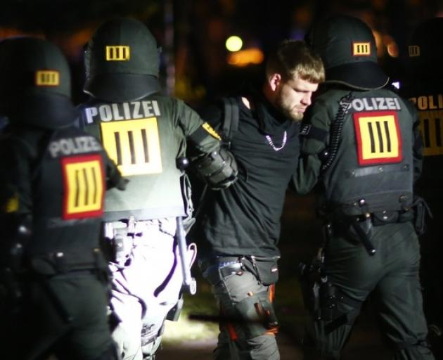 German police detain protester during a demonstration at the G20 summit in Hamburg. Photo: Reuters