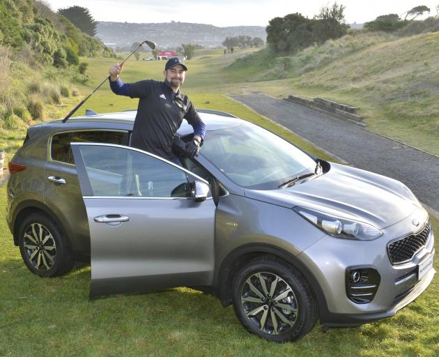 Josh Day (32), of Milton, hit a hole-in-one at Chisholm Links yesterday to win a new car. Photo: Gerard O'Brien