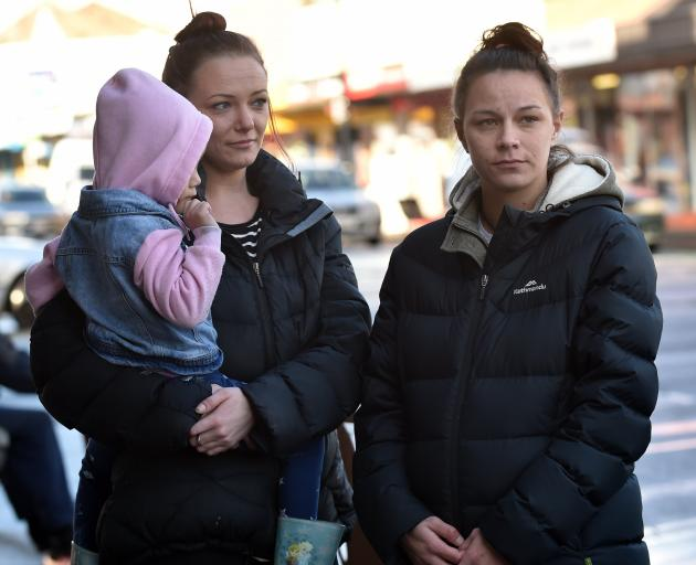 Amy Stuart, holding her daughter, and Kylie Taggart are at odds with the Ministry of Social Development about their situation. Photo: Peter McIntosh