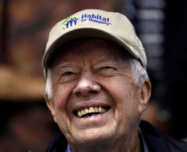 By Friday morning, former US President Jimmy Carter was smiling as he returned to the building site to help kick off the project's last day.