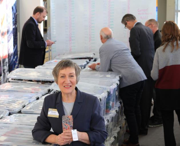 Holding the last tie counted, Irene Sparks relaxes with her world-record-breaking tie collection as her witnesses finalise the count in Oamaru on Saturday. Photo: Hamish MacLean