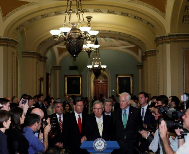 Senate Majority Leader Mitch McConnell, flanked by Senate Republican Leaders, speaks with reporters about healthcare legislation. Photo: Reuters