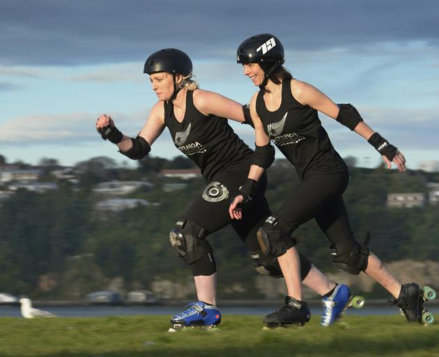 Roller derby skaters Charmaine Reveley (left) and Mel Huddy race along Portsmouth Dr in Dunedin yesterday. The pair have been selected to represent New Zealand at the Roller Derby World Cup next year. Photo: Gerard O'Brien