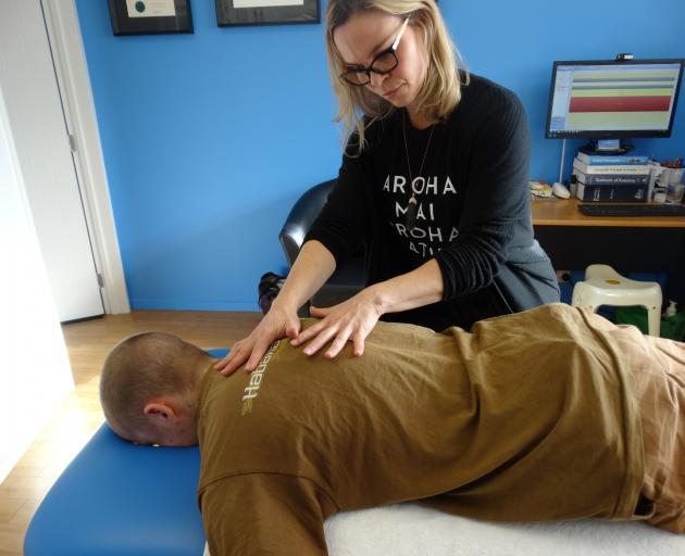 Wanaka osteopath Liana Poole treats Ferdia O'Connell in her Wanaka Osteopathic Clinic.