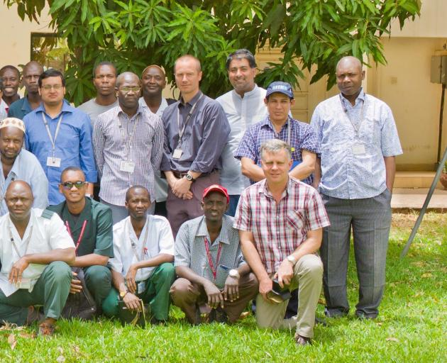 Professor Philip Hill (front, right, kneeling) at the Medical Research Council unit in Basse, Gambia. PHOTO: SUPPLIED