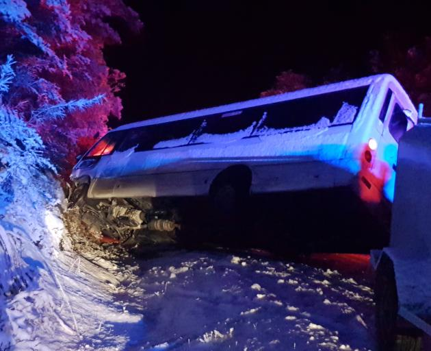 The bus that rolled on the the Haast-Makarora Rd on Tuesday night. Photo: Brett Arthur