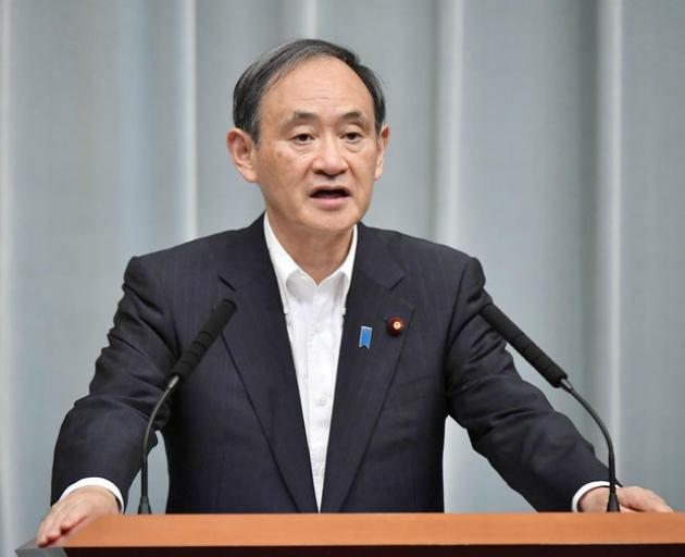 Japanese Chief Cabinet Secretary Yoshihide Suga speaks at a news conference about North Korea's missile launch. Photo: Reuters