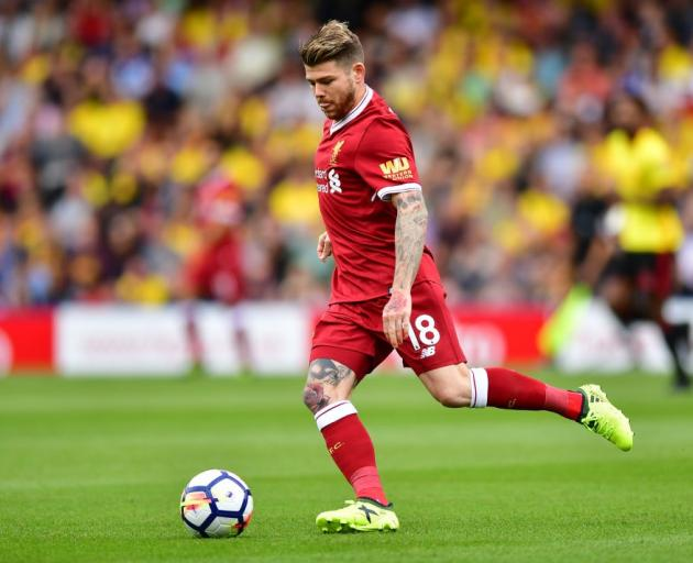 Liverpool's Alberto Moreno looks to play the ball during its season-opener against Watford. Photo...