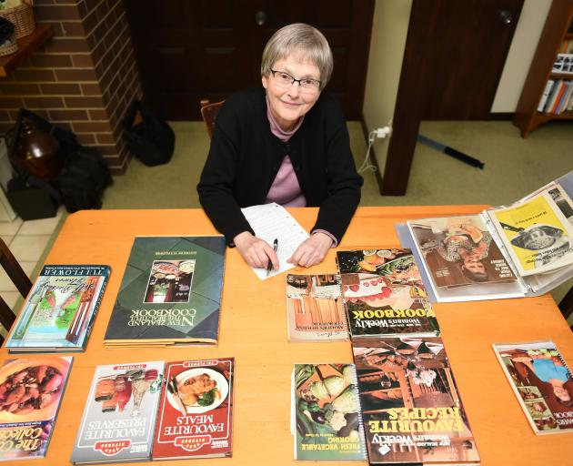 Emeritus Prof Helen Leach with some of her collection of Tui Flower recipe books. Photo: Staff Photographer.