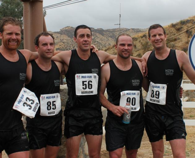 Dunedin firefighters (from left) Joe Dobson, Lee Mayer, Calvin Harradine, Cameron McLachlan and Tony McEntyre celebrate winning the ``mud run'' at the World Police and Fire Games in Los Angeles earlier this month. Photo: Supplied